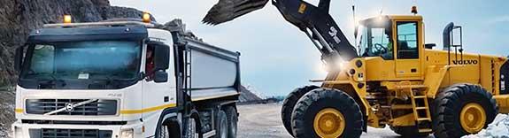 Перемещение и погрузка на самосвалы грунта и других материалов